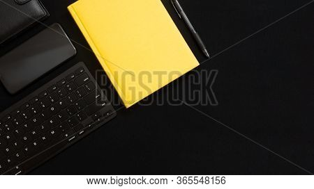 Flat Lay Composition With Black Pen, Computer Keyboard, Smartphone, Leather Wallet And Bright Yellow