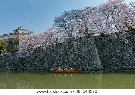 Himeji / Japan - March 31, 2018: People In A Tourist Boat In Himeji Castle Water Moat Admiring The B