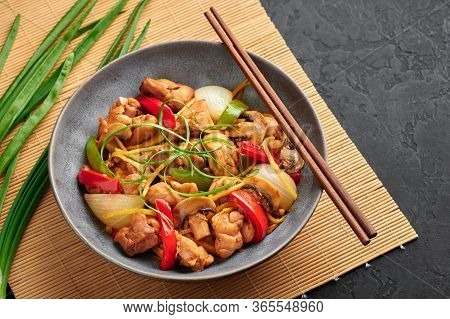 Thai Ginger Chicken Or Gai Pad King In Gray Bowl At Black Slate Backdrop. Gai Pad King Is Thailand C
