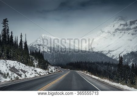 Scenic Highway Road Trip With Snow Mountain In Gloomy At Icefields Parkway, Canada