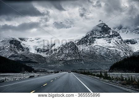 Road Trip With Snowy Rocky Mountains In Gloomy At Icefields Parkway, Canada