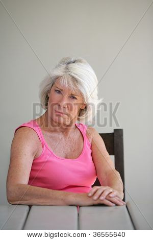 Senior woman sitting at a table