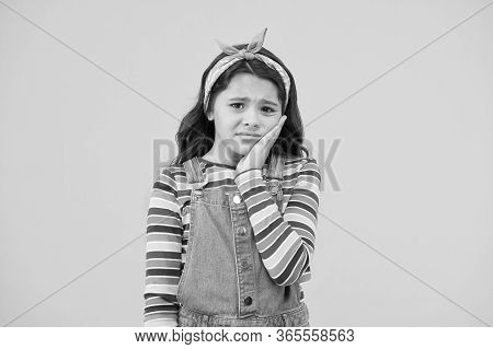 Dentist Appointment. Little Child Suffer From Toothache Yellow Background. Anti Toothache Remedy. To