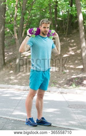 Riding Skateboard Just For Fun. Freedom And Drive. Athletic Man Hold Penny Board Outdoors. Skateboar