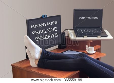 The Inscription Advantage, Privileges, Benefit Is On The Screen.legs In White Socks Lie On A Table W