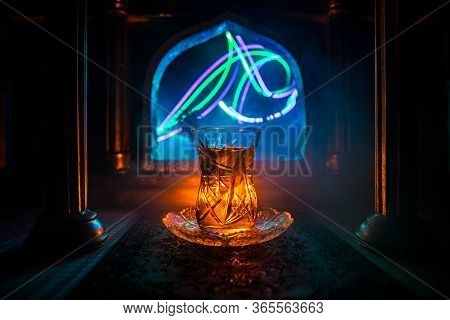 Arabian Tea In Glass Inside Room. Low Light Lounge Interior With Carpet. Selective Focus
