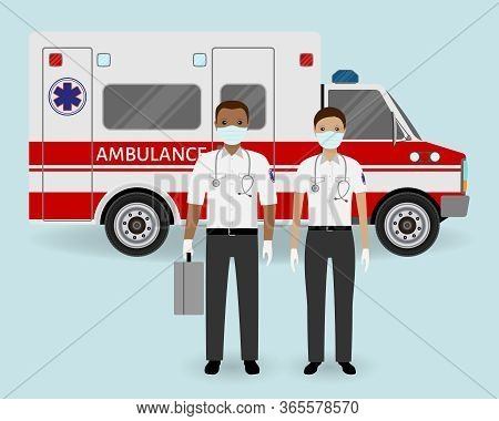 Hospital Staff Concept. Paramedics Ambulance Team With Medical Protection Masks On Ambulance Car Bac