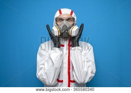 Resistance To Coronavirus. Shocked Disinfection Worker In Protective Suit And Respirator Is Panickin