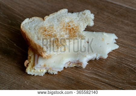 Bread Tossed To The Floor. Half Eaten Sandwich Thrown On The Floor. Thrown Into The Trash Food. Disc