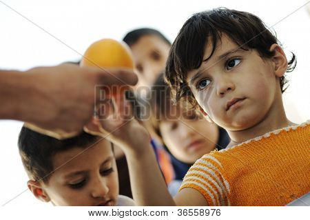Hungry children in refugee camp