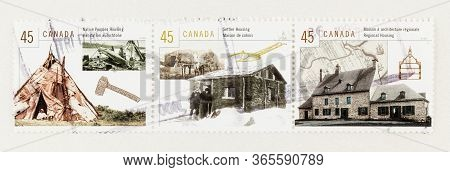 Seattle Washington - May 10, 2020:  1998 Stamps Featuring Canadian  Native, Settler And Regional Hou