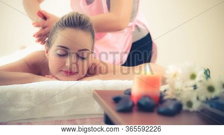 Woman Gets Back Massage Spa By Massage Therapist.