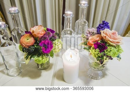 Candles And Flowers On The Laid Table To Create The Right Atmosphere For Your Party