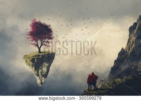 Couple On A Mountain Cliff Looking At A Floating Island With A Red Tree .