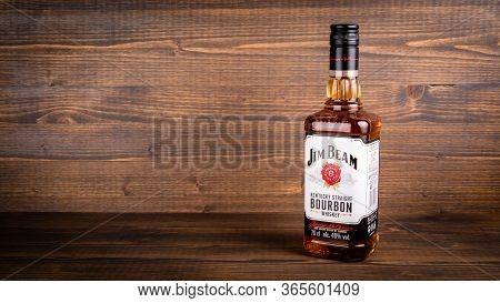 Bottle Of Jim Beam Bourbon On Wooden Background. Jim Beam Is An American Brand Of Bourbon Whiskey Pr