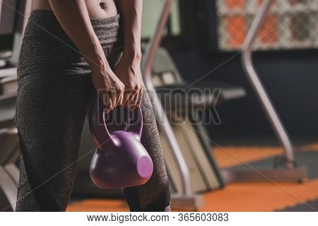 Sport Woman Fit Kettlebell Training In Gym Room. Sport Relax And Healthy Life In Indoor Or Sport Com