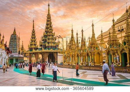 YANGON, MYANMAR - OCTOBER 17, 2015: Early morning worshippers visit Shwedagon Pagoda. Shwedagon Pagoda is the most sacred Buddhist pagoda in Myanmar.