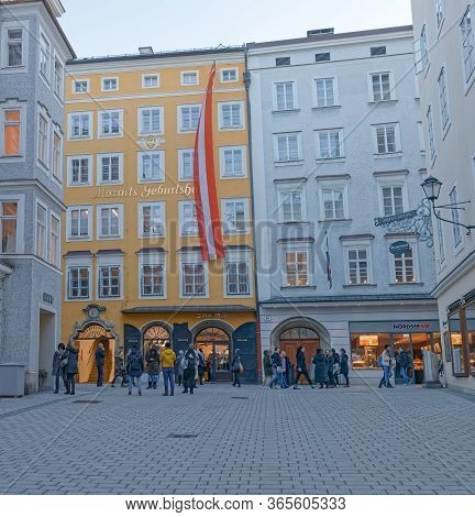 Salzburg, Austria, February 22, 2020: Tourists Gathered In Front Of Wolfgang Amadeus Mozarts Birthpl