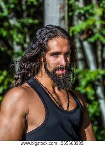 Handsome Bearded Man With Long Dark Hair. Sexy Bearded Model Man. Man Fashion And Style Concept. Por