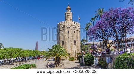 Sevilla, Spain - May 14, 2019: Golden Tower At The Riverbank Park In Sevilla, Spain