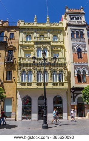 Sevilla, Spain - May 14, 2019: Historic Buildings At The Constiruticion Avenue In Sevilla, Spain