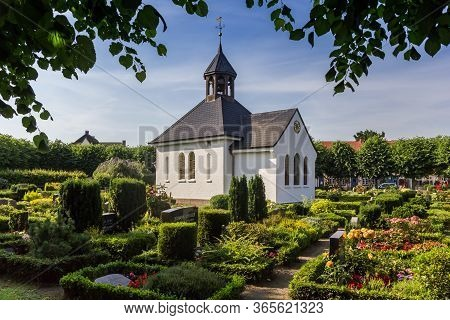 Schleswig, Germany - June 25, 2019: Little White Chapel At The Cemetary In Schleswig, Germany