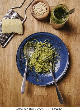 Bowl Of Basil Pesto And Pasta On An Old Wood Table.