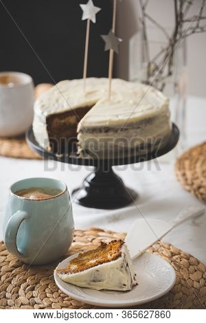 Closeup Of A Cup With Coffee And A Slice Of Homemade Cake On A Plate. Delicious Homemade White Cake