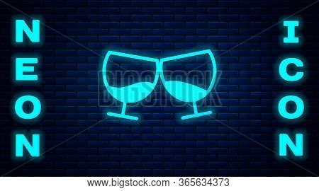 Glowing Neon Glass Of Cognac Or Brandy Icon Isolated On Brick Wall Background. Vector Illustration