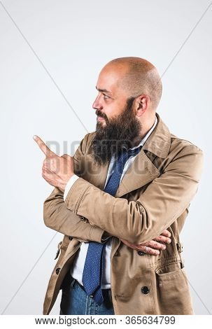 Bearded Businessman Portrait. Businessman Face Portrait. Businessman Portrait Showing Up With Finger