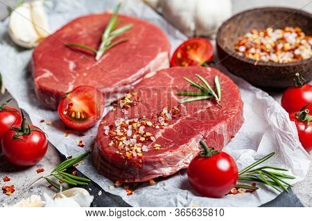 Raw Beef Fillet On A Slate With Spices. Raw Meat Beef Steaks Background.