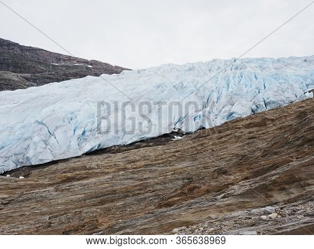 Famous European Svartisen Glacier Tongue In Nordland County In Norway, Cloudy Sky In 2019 Cold Summe