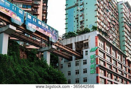 Chongqing, China - July 23, 2019: Metro Train Entering Residential Building For A Subway Station In