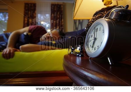 Morning Wake Up In The Bedroom. The Man Sleep. Early Clock Time At The Beginning Of The Day. It's Ha