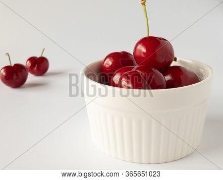 Fresh Cherries In A White Ramekin For Dessert