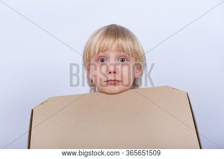 Surprised Upset Fair-haired Boy With Box In Hand On White Background. Pizza Delivery.