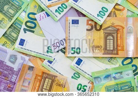 European Currenc Lies On The Table. Banknotes Five Hundred, One Hundred, Two Hundred, Fifty Euros Ar