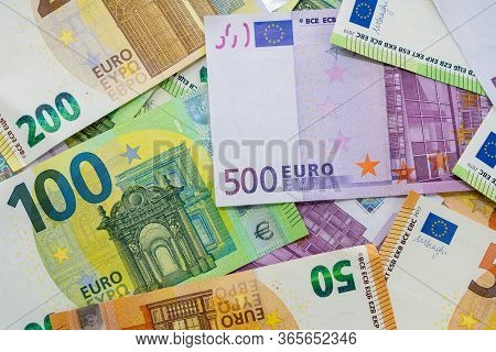 European Currency Lies On The Table. Banknot Five Hundred, One Hundred, Two Hundred, Fifty Euros Are