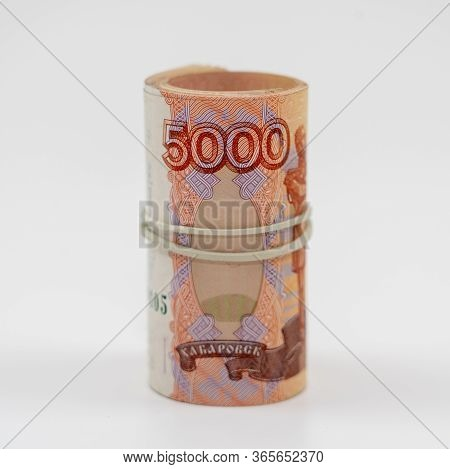 Banknotes Five Thousand Rubles 5000 In A Roll With An Elastic Band. Russian To Save. Close-up, White