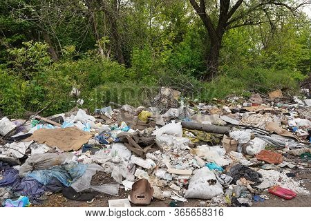 Background Of Rusty And Oxidized Old Objects Scattered In The Environment And Highly Polluting
