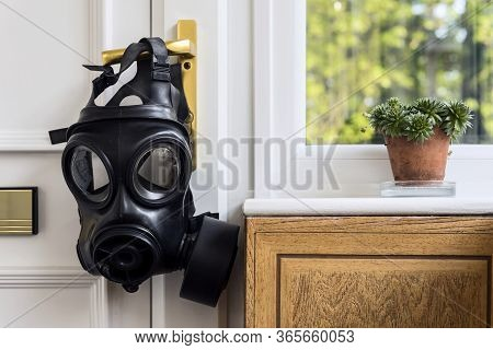 Sas Gas Mask Hanging Off The Entry Door Handle. Home Isolation.