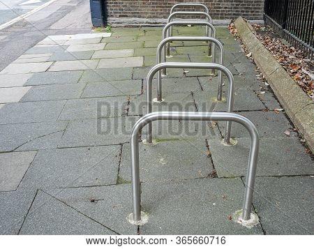 Row Of Empty Sheffield Stand Bike Racks On The Pavement