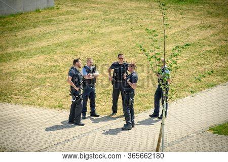 Lehl, Germany - May 9, 2020: Aerial View Of Group Of German Polizei Police Officers In Green Park Su