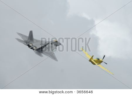 Fighter F-22 Raptor And P-51 In Airshow