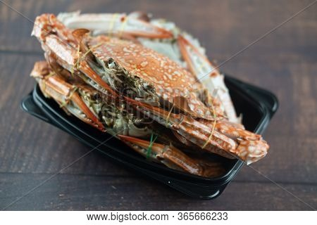 Steamed Crab In Black Disposable Plastic Container Steamed And Cooked Before Delivery. Thai Style Se