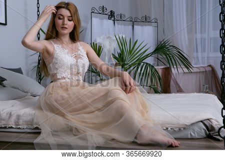 The Concept Of Tenderness And Sensuality. Beautiful Model Posing In The Bathroom In A Sexy Negligee.