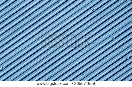 Metal Plate Wall In Navy Blue Tone. Abstract Architectural Background And Texture For Design.