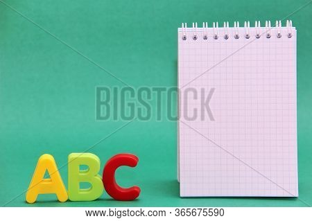 English Abc Alphabet Letters And The Notepad Page. Learning Foreign Language.