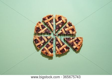 Blueberries Tart With Lattice Crust On A Green Background, Above View. Homemade Pie With Blueberries