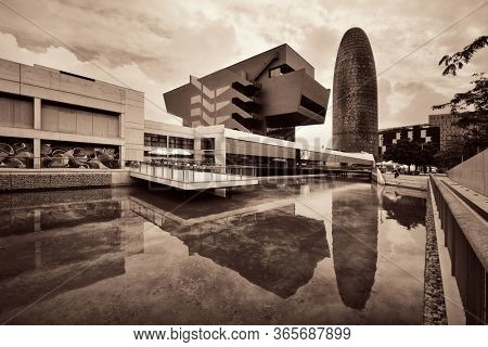 BARCELONA, SPAIN – MAY 13, 2019: The Torre Glories and pool water reflection in business district.